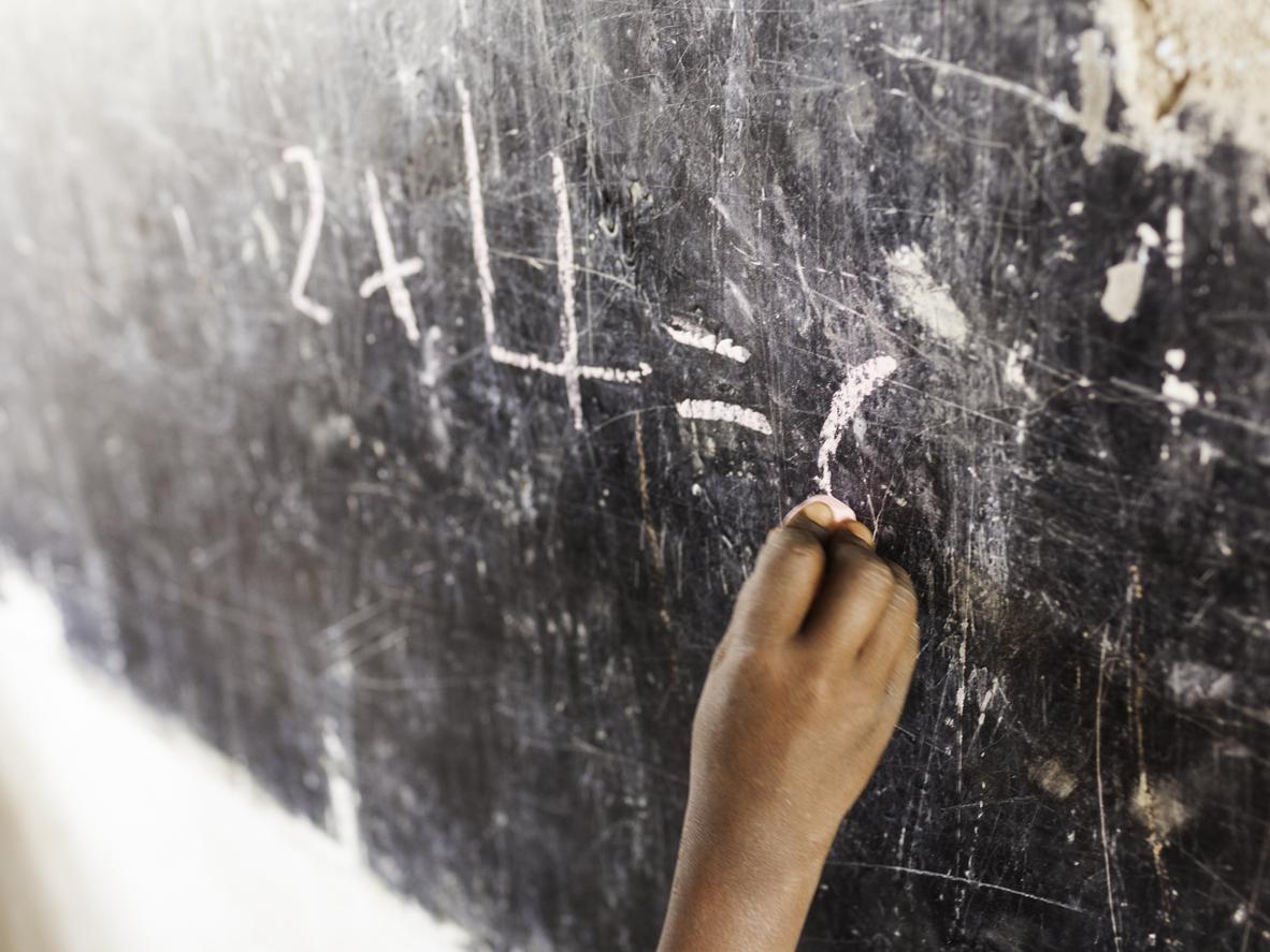 African schoolgirl writing on blackboard - RELEASE OF ABDUCTED SCHOOLGIRLS IN NIGERIA