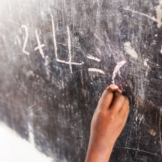 African schoolgirl writing on blackboard - RELEASE OF ABDUCTED SCHOOLGIRLS IN NIGERIA