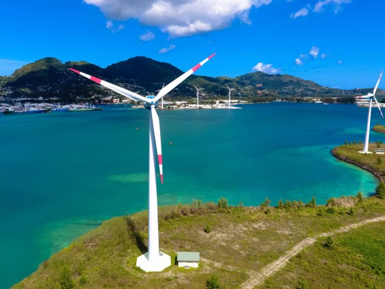 Wind turbines producing clean electricity in Victoria, Mahe Island, Seychelles.