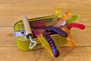 can, worms, sweets