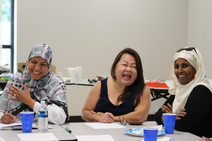 Three workshop attendees laughing together