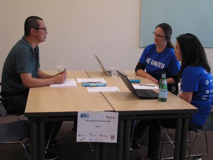 Client and attorneys volunteer at legal clinic