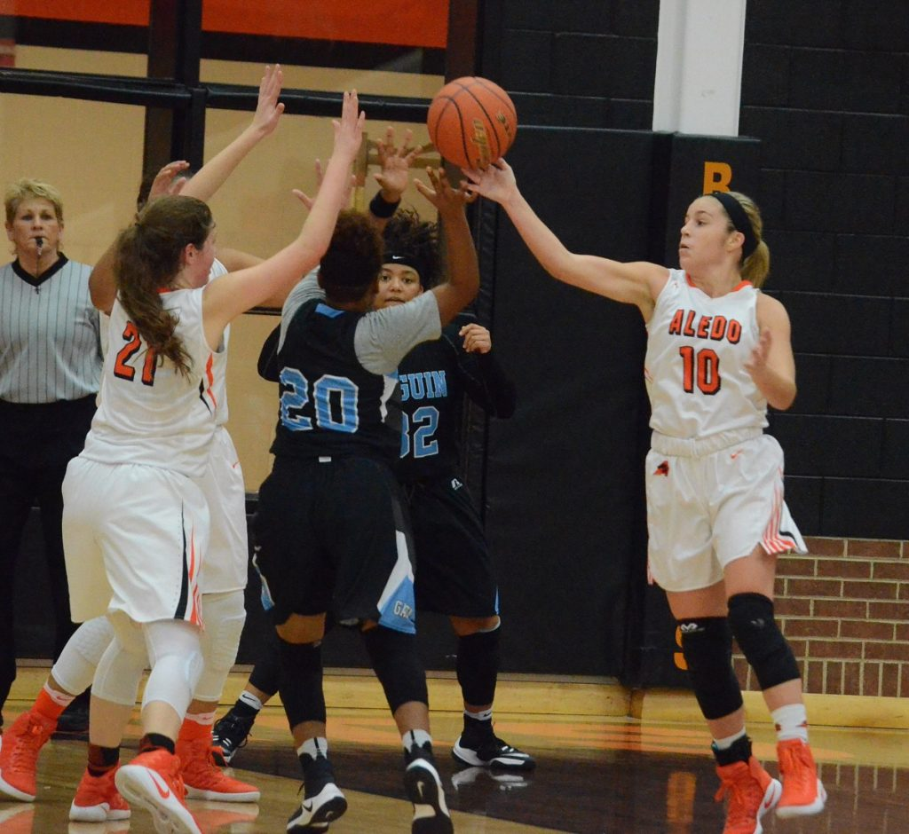 Aledo freshman guard Taylor Morgan (10) sends a pass to a teammate Saturday during the Ladcyats' victory over Arlington Seguin. Morgan scored a game-high 24 points.