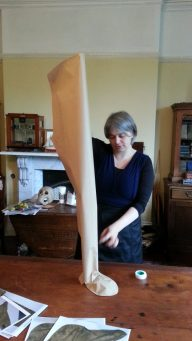 Measuring the leg of one of the skeleton costumes. Photo credit: Alistair Brown