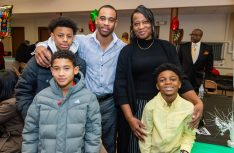 """Dwayne Clements, Jr., and his mother Kimberly Clements, with his children, from Terrance Stevens, Jr., 15, Ethan Clements, 10, and nephew Noah Kinskey, 7, at the """"Men with a Purpose"""" luncheon, a Dr. Martin Luther King, Jr. event celebrating men, at Grace Baptist Church in Waterbury. The event was sponsored by the Waterbury NAACP Youth Council."""