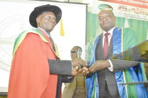 The Vice-Chancellor, Kolawole Salako (Right), presenting a plaque of honour to the 57th Inaugural Lecturer of the University.