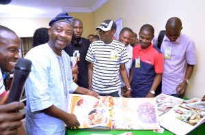 Always a good mixer. Representative of the Vice-Chancellor, the Deputy Vice-Chancellor (Development), Professor Lateef Sanni (2nd Left) beaming with infectious smile while appreciating the artistic display of Photography by Professional Photographers at the Workshop