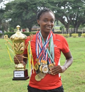 Naomi Adeoyin displaying her trophy and some of the medals she won at tournaments.