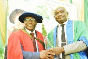The Vice-Chancellor, Prof. Kolawole Salako (Right) presenting a plaque to the 58th Inaugural Lecturer of the University, Prof. Michael Ozoje