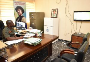 The Registrar, Dr. Bola Adekola amid his tight schedule spared time to watch the Vice-Chancellor, Professor Kolawole Salako presenting the result of Presidential Election in Lagos State from his television set