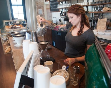 Maya Bernier makes coffee at Smile Tiger, a new Kitchener cafe/roastery.