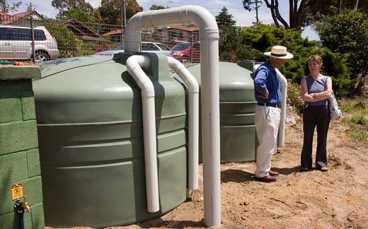 The community garden's tanks store rainwater harvested from the roof of the strawbale classroom. The tanks are gravity filled and the water irrigates the garden.