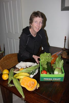 The community garden network's Fiona Campbell with her Sydney Organic Buyers Randwick weekly box of in-season food.