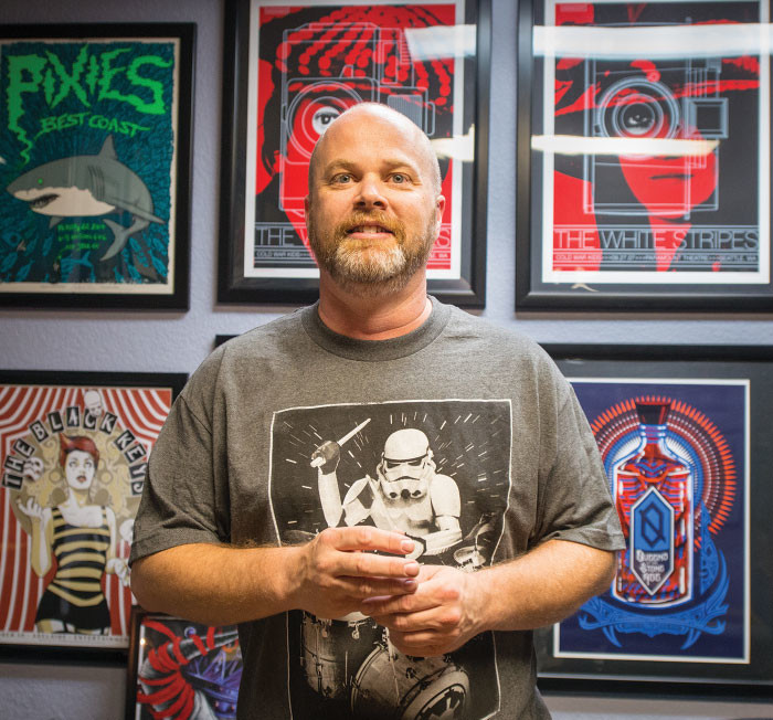 in my parents basement co owner ryan acuff displays art prints at the