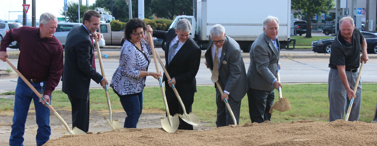 State and local representatives break ground at William Cannon Drive for an I-35 project.