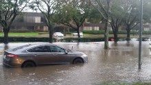 Storms wipe out Houston roads, cars stranded in high water
