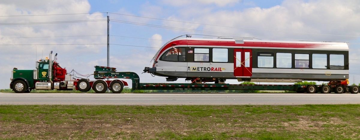 Two trains, each consisting of two cars and an engine car, came across the Atlantic Ocean from Switzerland to Galveston, and traveled up to Austin by truck.