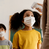 asymptomatic screening starting with temperature for school children