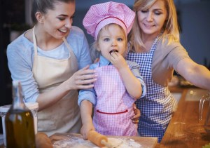 child cooking with adults