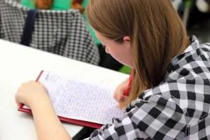girl writing paper