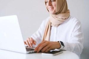 woman using laptop smiling