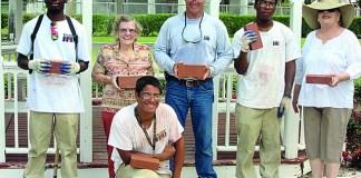 HJCC students lay bricks in Woman's Club garden