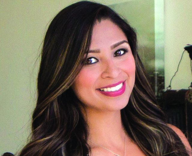 Ana Rivera deeply involved in her work and community