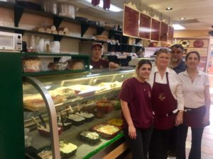 are Risa Levenson, Tonya Gay, Orly Cooley, Nick Poulos, and (behind the counter) Chris Poulos.
