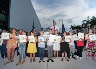 Miami-Dade County Commissioner Joe A. Martinez presents certificates and trophies to the group project winners. (Photo by Ryan Holloway/Miami-Dade County)