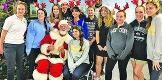 Palmer Trinity School hosts fifth annual holiday party at Chapman Partnership