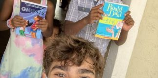 Student creates traveling library to bring books to kids at home
