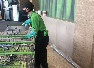 Guillermo Acosta rounds up carts at Publix Supermarket #223 on S. Dixie Highway.