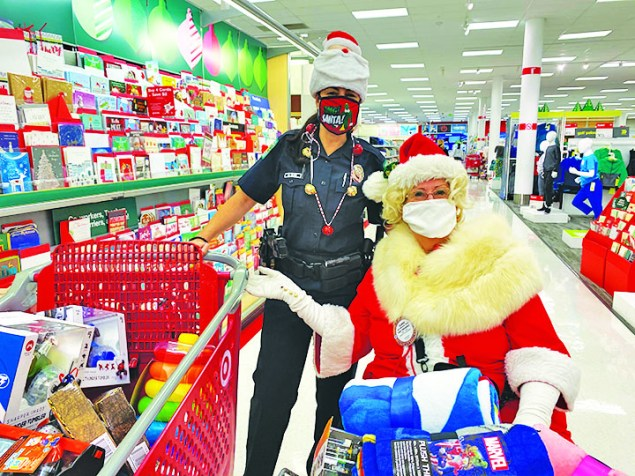 Santa and police shop for $600 worth of toys for foster children