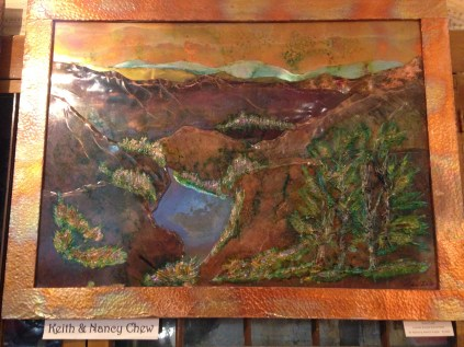 Inside a gallery at the art walk. This painting is a 3D relief.