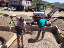 Interns Sarah and Dan move drain rock around as fast as Dusty can pour.