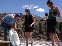 Interns Stacy and arah help Dick hte plumber install radiant heat tubing on the rebar.