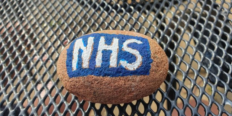 pebble painted with NHS logo