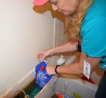 Volunteer Installing Tank bank