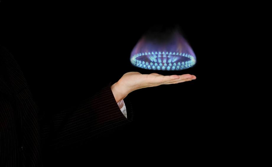 gas ring hovering over a hand
