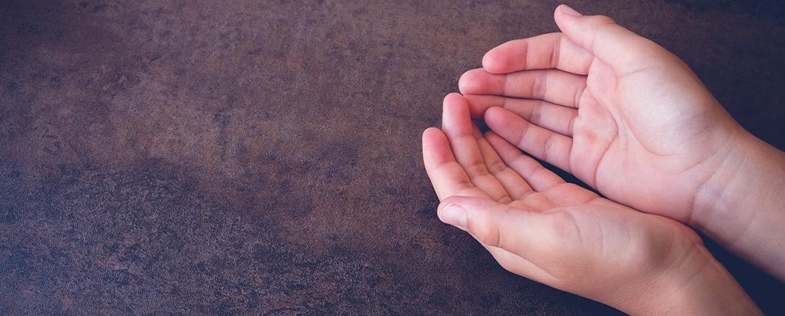 Praying palms up.