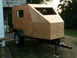 compact camping trailer build with large front window