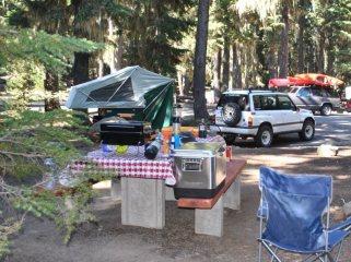 compact camping trailer campsite setup