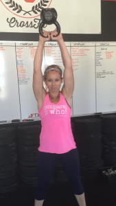 """Crossfit's infamous kettle bell swings! Here's my friend Lindsey doing some in her """"Compared to Who"""" shirt!"""