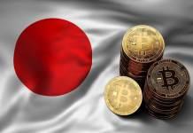 monety bitcoin na fladze japonii