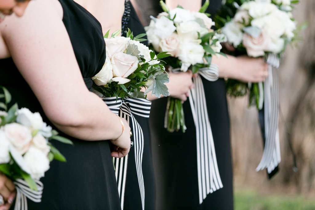 White wedding bouquets with black and white striped ribbon for Temecula wedding at wedgewood galway downs wedding venue