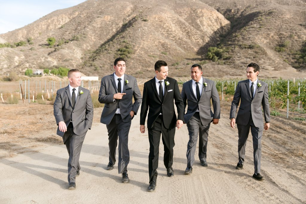 Groomsmen in black suits outside for Temecula wedding at wedgewood galway downs wedding venue