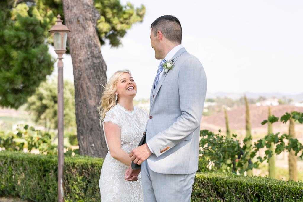 Bride and groom first look at callaway winery wedding venue in temecula california