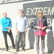 Photo on the rooftop of Art Center's Media Design Practices Wind Tunnel in Pasadena, CA, of Christian Denhart, Eric Lewallen, Marcus Filipovich, Anne Burdick & Maggie Hendrie, announcing the awards for MDP's Extreme Wearables Designathon