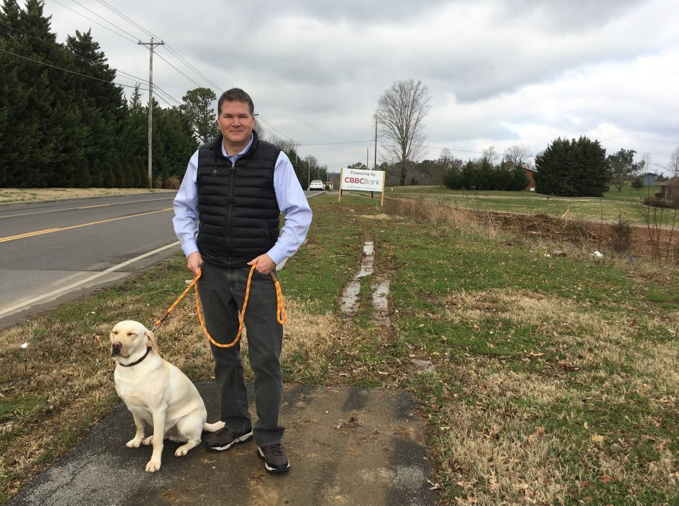 Larsen Jay with his dog on Northshore Drive