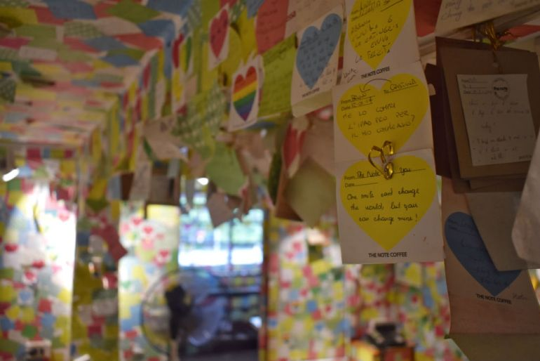the note coffee shop wall notes Hanoi Vietnam